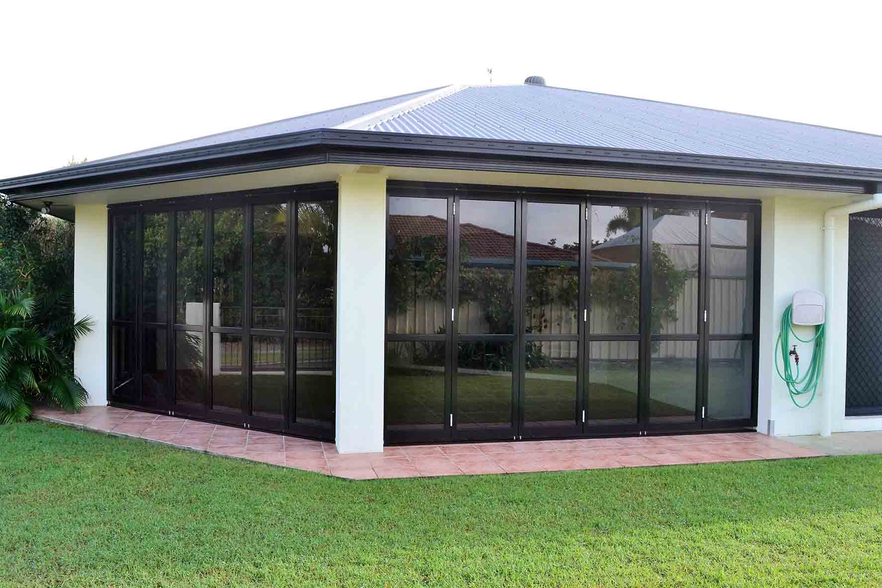 The outside of a house with black bifold doors